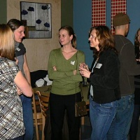 Agrologists networking at the Friday night social at the Green Olive Bar & Grill
