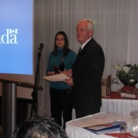 Presentation by Paul Littlewood (right), CFIA Regional Director, to the Fraser Valley Branch AGM attendees